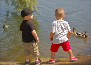 2 cute boys by water